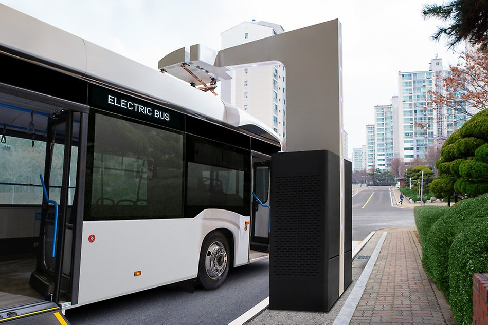 Electric bus at a charging station. Photo.