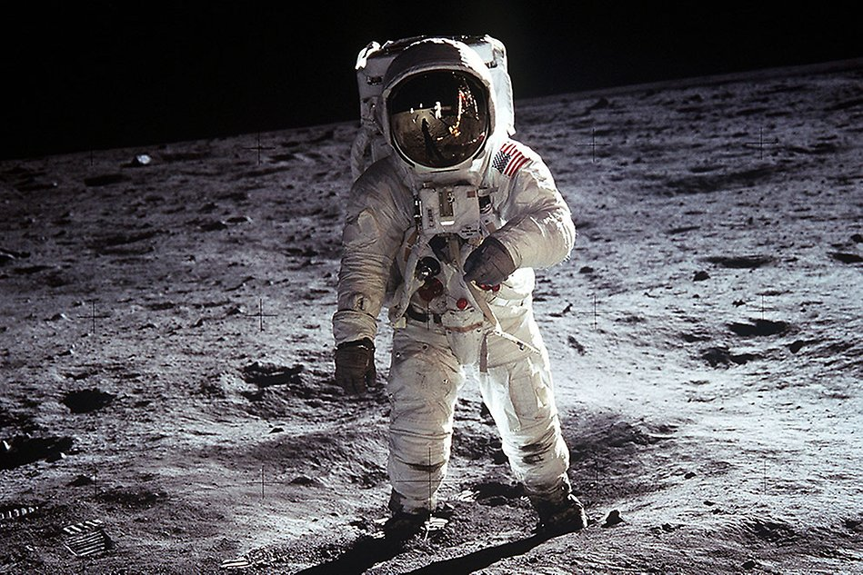 Astronaut standing on a grey surface, the moon